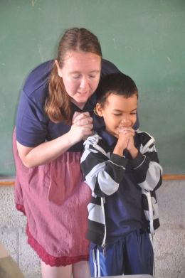 One of our newer kindergarten students Jose Manuel praying with Miss Rachel