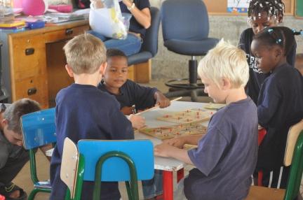 Moses and Leyton enjoying puzzles in PK4.