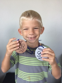 Noah was proud of his silver and bronze medals he won!
