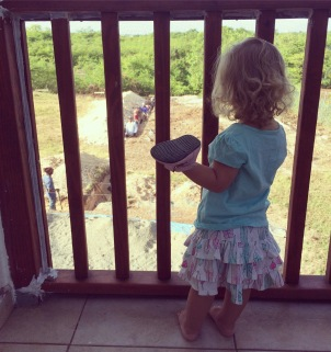 The footers are being dug for our second 8-unit apartment building. Caleigh loves watching the men work from our back porch!