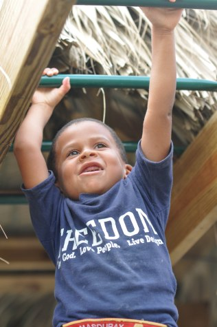 Eliezer was all smiles on the monkey bars