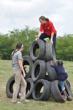 Interns Karli and Leah testing out the tire mountain.