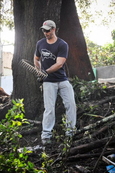 Kurt working on cleaning up debris and trash.
