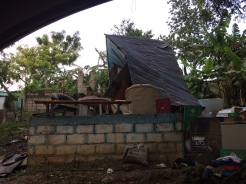 This home lost its roof/walls.