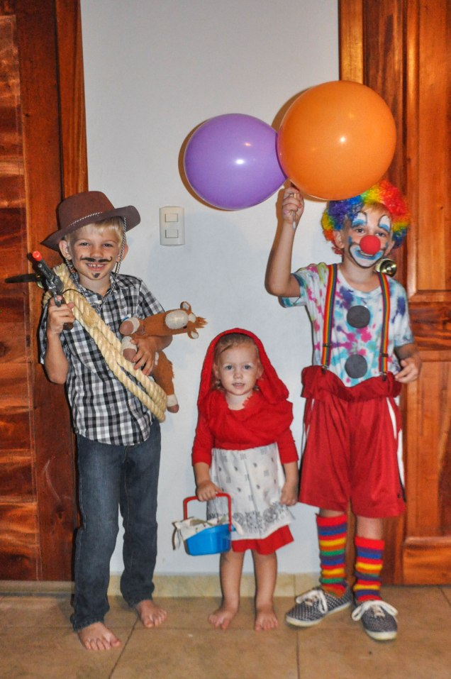 Trick-or-treat from our cowboy, clown, and Little Red Riding Hood!