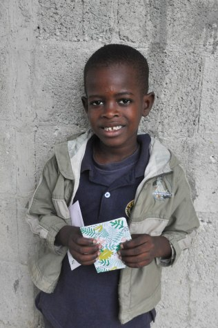 Smiles from Angel as he reads a note from his sponsor