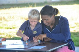 Leyton with his teacher Miss Flavia