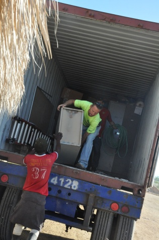 Jason, Jason, and our Dominican crew unloading our latest container!