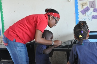 Mery working with her first graders