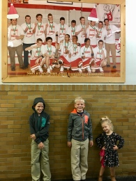 Posing under a poster of dad's high school basketball team as ACSI state champs!
