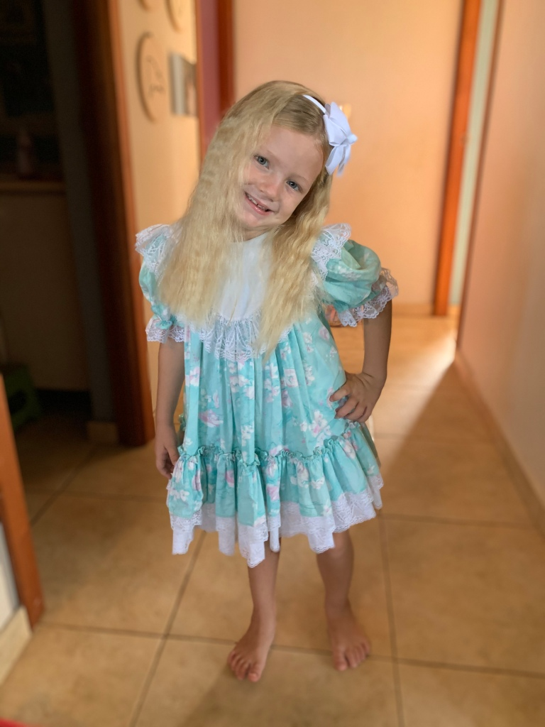 Talk about vintage! Caleigh wore one of Mommy's dresses to church one Sunday!