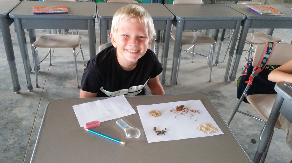 MK school continues. Susan sent me this sweet picture of Leyton classifying soils!